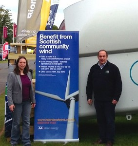 Leila Sharland of Sharenergy and Sheridan Jenkins of RM promoting Heartland in front of a WTN turbine
